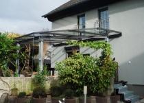 schöne Terrassenüberdachung aus Glas